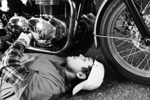 young mechanic repairing a vintage motorcycle